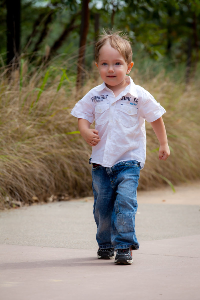 image of a young boy walking directly towards the camera