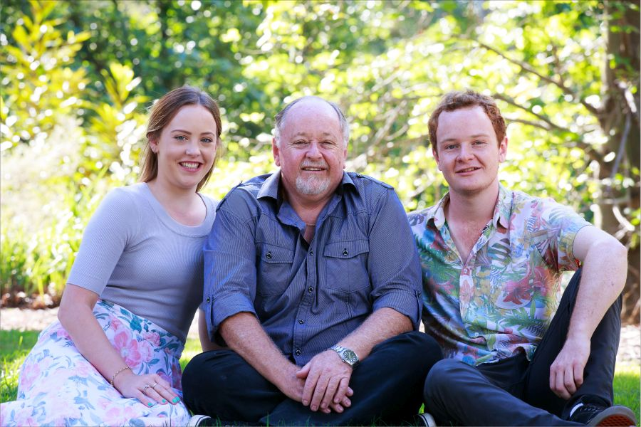 fqmily portrait sitting daughter father and son